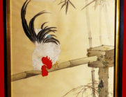 Cock and hen under bamboo